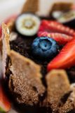 Extreme closeup of dessert with tonka cream, chocolate and berries Royalty Free Stock Photo