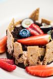 Extreme closeup of dessert with tonka cream, chocolate and berries Royalty Free Stock Images