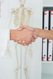 Extreme closeup of a doctor and patient shaking hands Stock Photography
