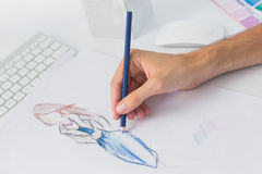 Extreme closeup of a fashion designer working on designs Royalty Free Stock Photo