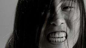 Extreme closeup of female asian monster screaming slow motion black and white stock footage