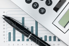 Extreme closeup of a fountain pen and charts Stock Photo