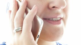 Extreme closeup photo of female lips talking by phone stock photos