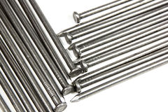 Extreme Closeup of Large Wire Nails on White Royalty Free Stock Image