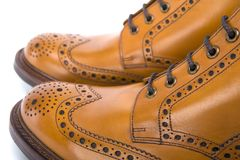 Extreme Closeup of Mens Tanned Brogue Leather Boots Royalty Free Stock Photos