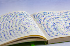 Extreme closeup of open notebook with handwritten lorem ipsum t. Ext with shallow focus on a ruled background royalty free stock images