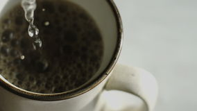 Extreme closeup of Pourring Hot Water for Instant Coffee stock video