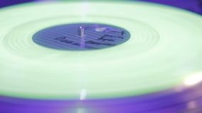 Extreme closeup of record rotating on sound deck, light flashing. Stock footage stock video footage