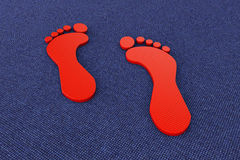 Extreme closeup red footprints Royalty Free Stock Image