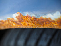 Extreme closeup of rust on vehicle above wheel Stock Image