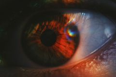 Extreme closeup shot of a beautiful human eye with light shining on it stock images