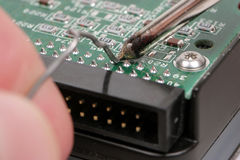 Extreme Closeup of Soldering a Harddrive Stock Image