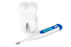 Extreme closeup tooth with thermometer Stock Photo