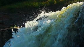 Extreme closeup of turbulent waterfall in the woods, wild nature. Stock footage stock video