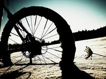 Extreme contrast. Mountain bike stay in powder snow. Lost path  in deep snowdrift. Stock Photo