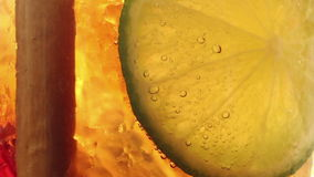Extreme CU of a slice of lime hanging suspended at the lower-middle top of a stock video footage