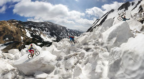 Extreme cyclist and mountain biking in the icefall stock photos