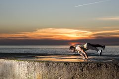 Extreme dancer doing tricks and powermoves. VILA NOVA DE GAIA, PORTUGAL, 30 DEC 2014, extreme dancer doing tricks and powermoves at the beach and Vila Nova de royalty free stock image