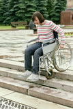 Extreme descent for invalid. Woman  on a wheelchair in park Royalty Free Stock Photo