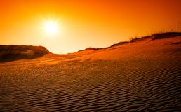 Extreme desert landscape with orange sunset. Golden textured sand Stock Photo