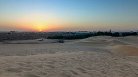 Extreme desert landscape timelapse with orange sunset, beautiful sandy background with hot sunlight, United Arab stock video footage