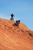 Extreme downhill. On red loam hills Stock Image