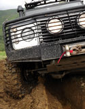 Extreme driving off-road vehicle on the dirt mountain road Stock Images