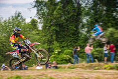 Extreme enduro MOTO SPORT Rider in the action. Uzhgorod, Ukraine - May 21, 2017: Extreme enduro MOTO SPORT Rider in the action. Motion blur with flying dirt stock photography
