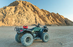 Extreme entertainment on a 4-wheeler in the desert royalty free stock images