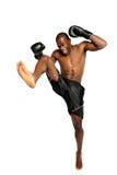 Extreme Fighting Athete kicking Royalty Free Stock Images