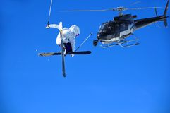 Extreme  filming. A girl ski jumper performing a high jump being filmed by a team in a helicopter Royalty Free Stock Photography