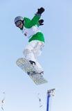 Extreme Fliege der Snowboardfrau Stockbild
