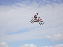 Extreme FMX stunt rider jumps high into the air Stock Image