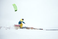 Extreme freestyle ski jump with young man at winter season. snowkiting. Stock Images