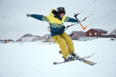 Extreme freestyle ski jump with young man at winter season. snowkiting. Royalty Free Stock Photos