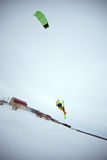 Extreme freestyle ski jump with young man at winter season. snowkiting. Stock Photography