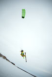 Extreme freestyle ski jump with young man at winter season. snowkiting. Royalty Free Stock Photography