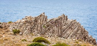 Extreme geological folds , anticlines and synclines, in Crete, Greece royalty free stock image