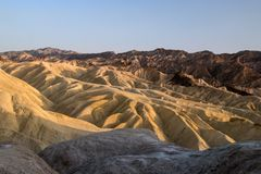 Mountain ridges of Zabriskie Point while setting sun, Death Valley National Park, California, USA stock photos