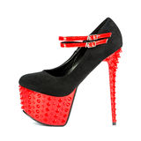 Extreme high heels shoes with platform and spikes. Extreme high heels shoes with platform sole, stiletto, and spikes in red and black Stock Photo