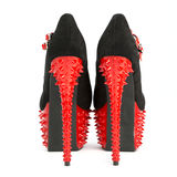 Extreme high heels shoes with platform and spikes Royalty Free Stock Image