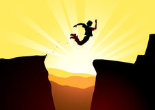 Extreme jump against a rising sun Stock Photography