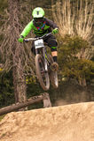 Extreme jump on a bike in forest. During competition downhill Stock Images