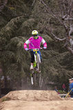 Extreme jump on a bike in forest Royalty Free Stock Photos