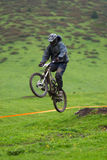 Extreme jump on downhill race Royalty Free Stock Photos