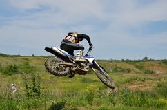 Extreme jump motocross racer by motorcycle Stock Photo