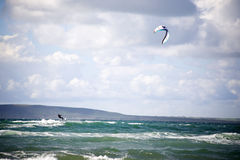 Extreme kite surfer holding on Royalty Free Stock Image