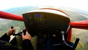 Extreme lesson on sports plane, POV of man looking at control panel, adrenaline. Stock photo stock image