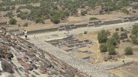 Extreme long shot from the pyramid of the sun, the ancient ruins of the Mayan city of Teotihuacan. high season tourist