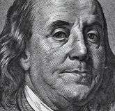Extreme macro of 100 dollar bill with Benjamin Franklin portrait royalty free stock image